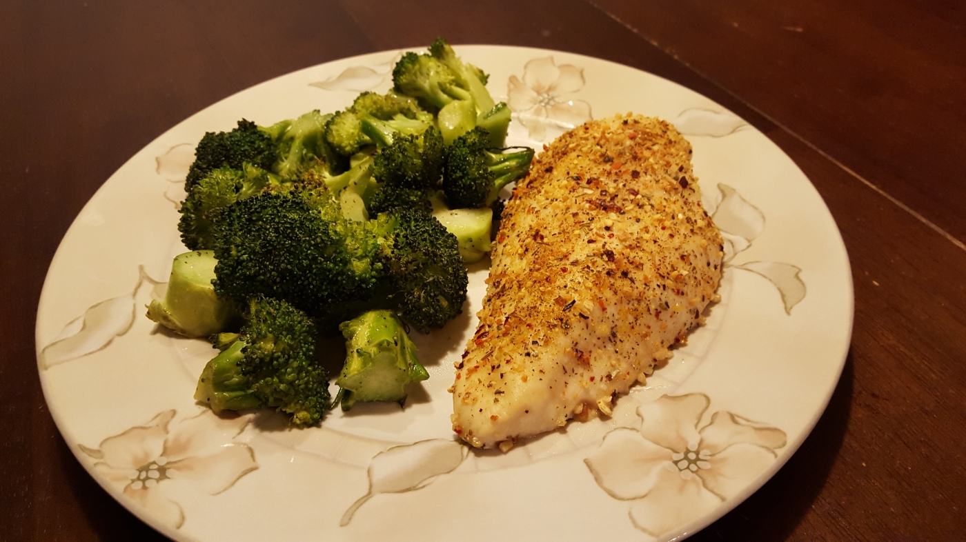 dinner plate with a baked chicken breast and some roasted broccoli